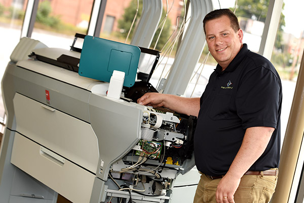 Image of Print-O-Stat's Large Format Printer Service Technicians